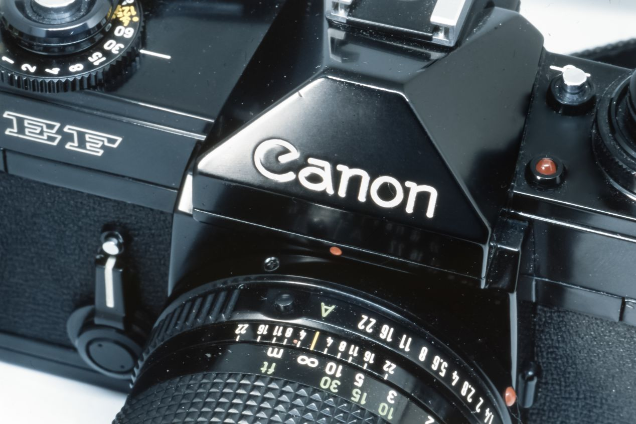 The Canon brand name on the pentaprism housing. Taken with a Nikon F5 and a Macro Tokina AF 100mm f./2.8 on Fujichrome Provia 100F.
