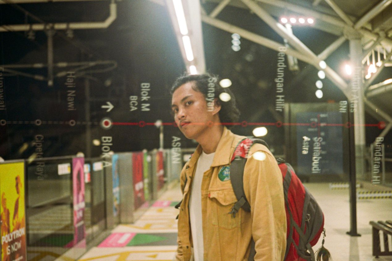 Self-portrait of a night traveller. Shot on Ricoh 500 GX with Kodak Portra 400.