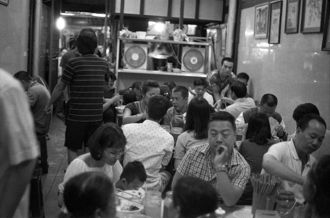 """This photo was taken at an incredibly busy """"hole in a wall,"""" which only served phở. There are no individual tables. Get in, get out. The food is delicious."""