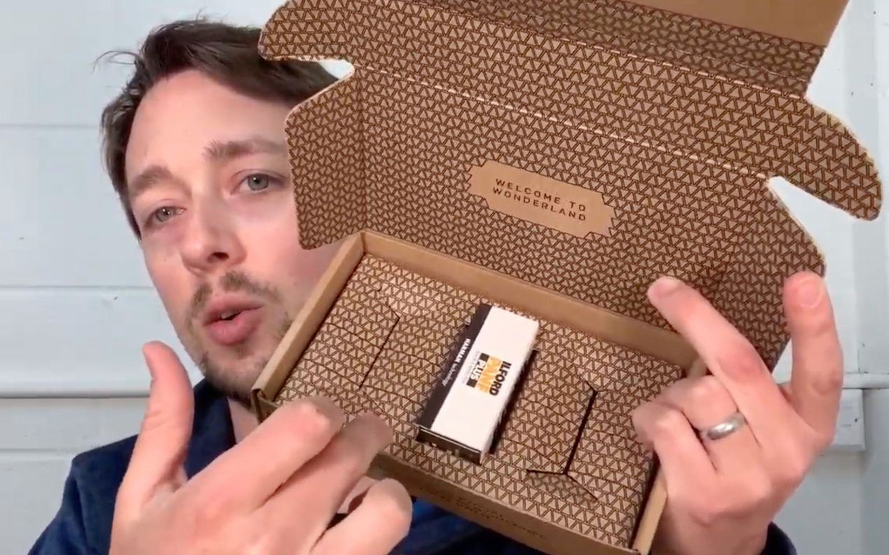 Paul is demoing Analogue Wonderland's new packaging design. This is a screen capture from the video in the linked AW blog article.