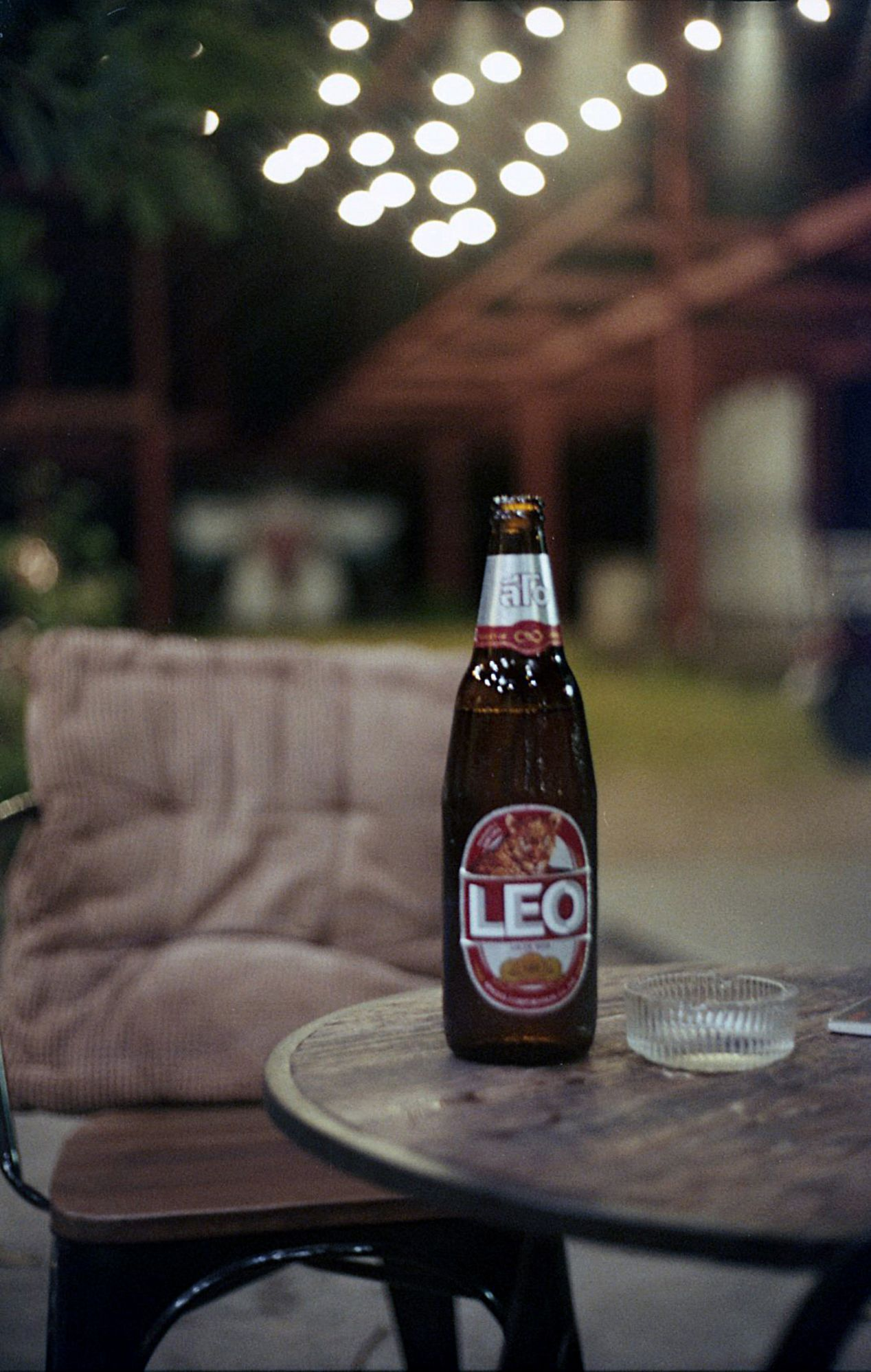 Electro 35 with Agfa Vista 200. The bottle is a bit out of focus here; I'm adding this photo to show the bokeh and the close-distance focus falloff with the 𝒇1.7 Yashinon lens at night.