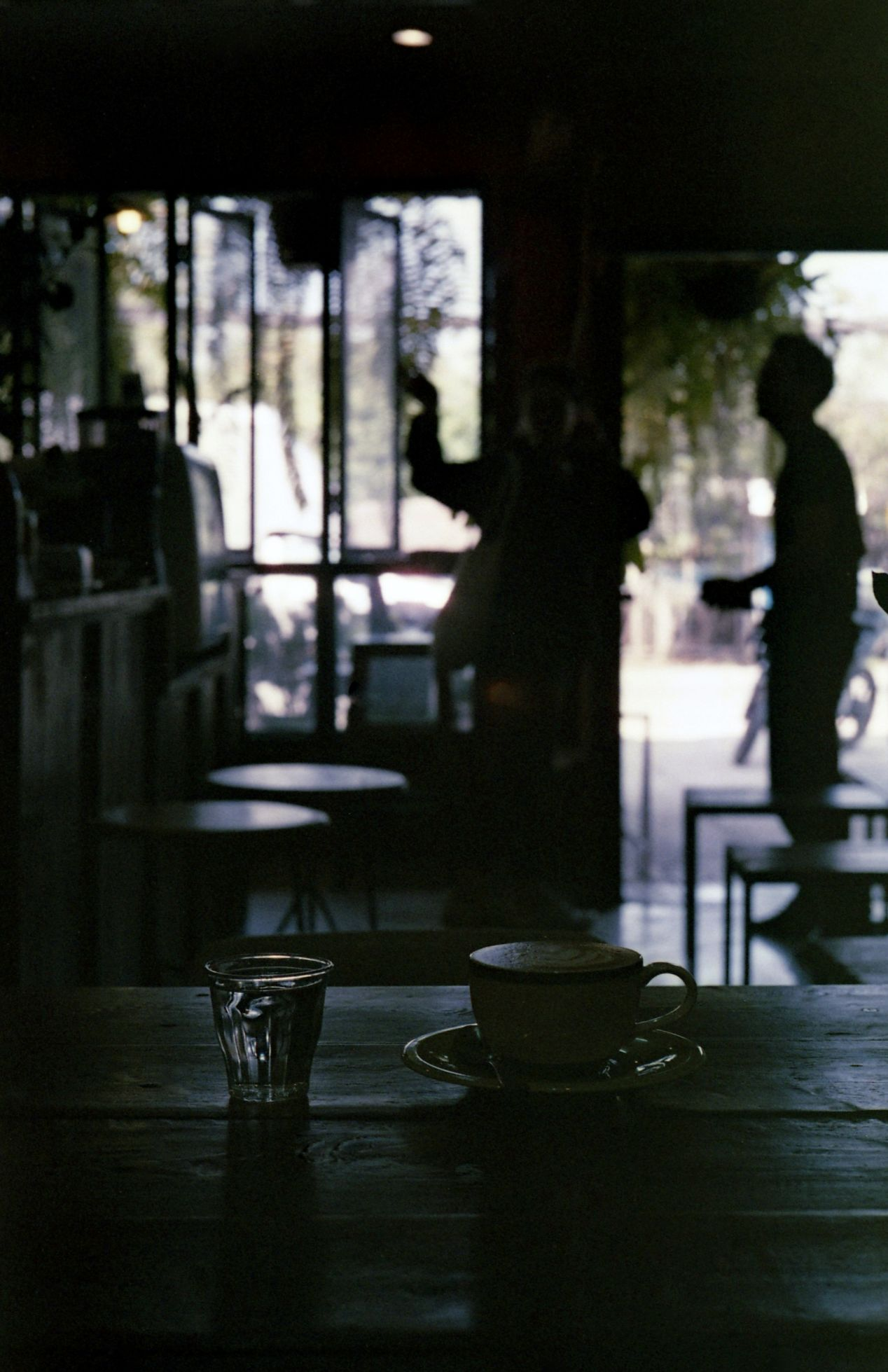 """In situations like this, the camera would naturally expose for the coffee shop interior, leaving the stuff in the windows over-exposed. Wanting to do the opposite, I've set it to ISO 1000, which made the """"electric brain"""" think that the film (Fuji Color 400) is 1.3 stops faster than it really is."""