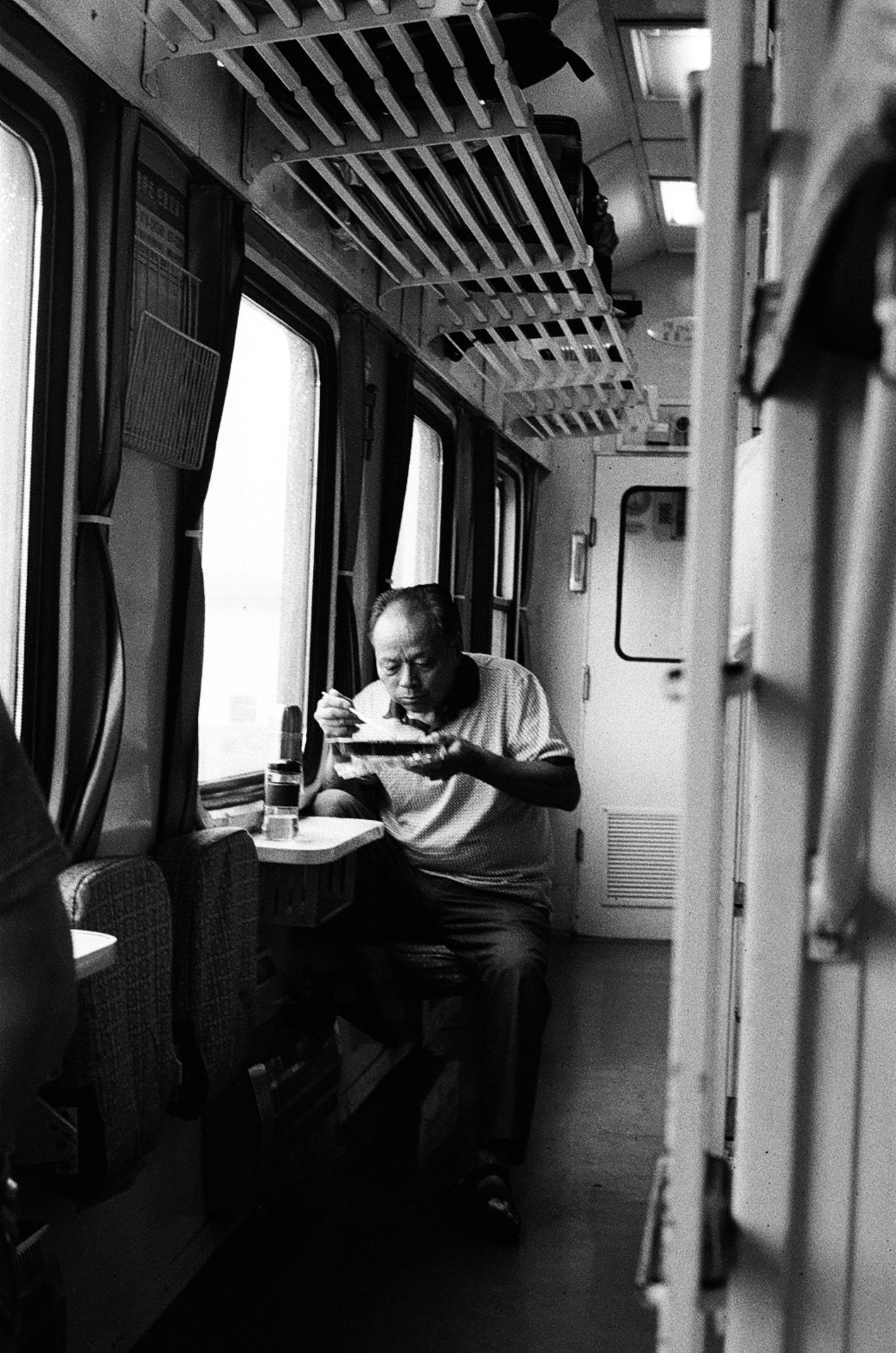 A scene from an eighteen-hour sleeper train ride in China.