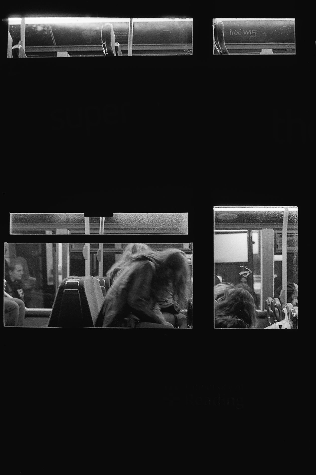 Dirty windows and boring bus rides home. Kodak Tri-X, pushed to 1600.