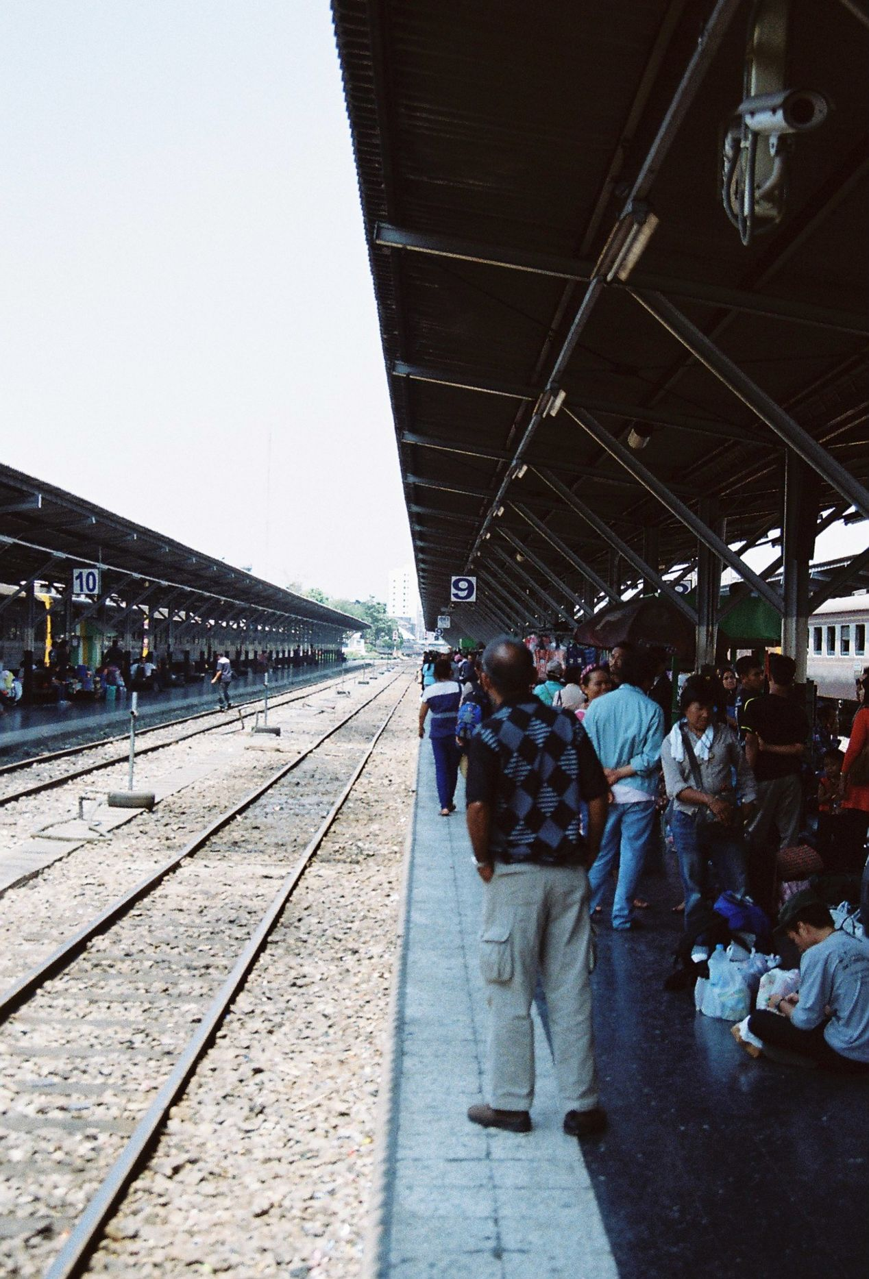 People waiting for a train. Shot with Yashica FX3 Super 2000 on Kodak Color Plus 200.