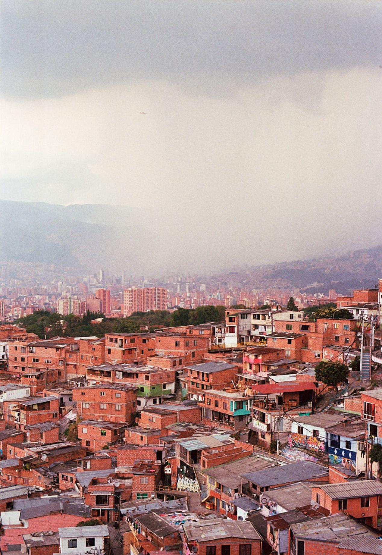 Downtown Medellín engulfed in heavy rain clouds. Shot on Kodak Ektar 100 with Minolta XD-7 and MD Rokkor 50mm f/1.4.