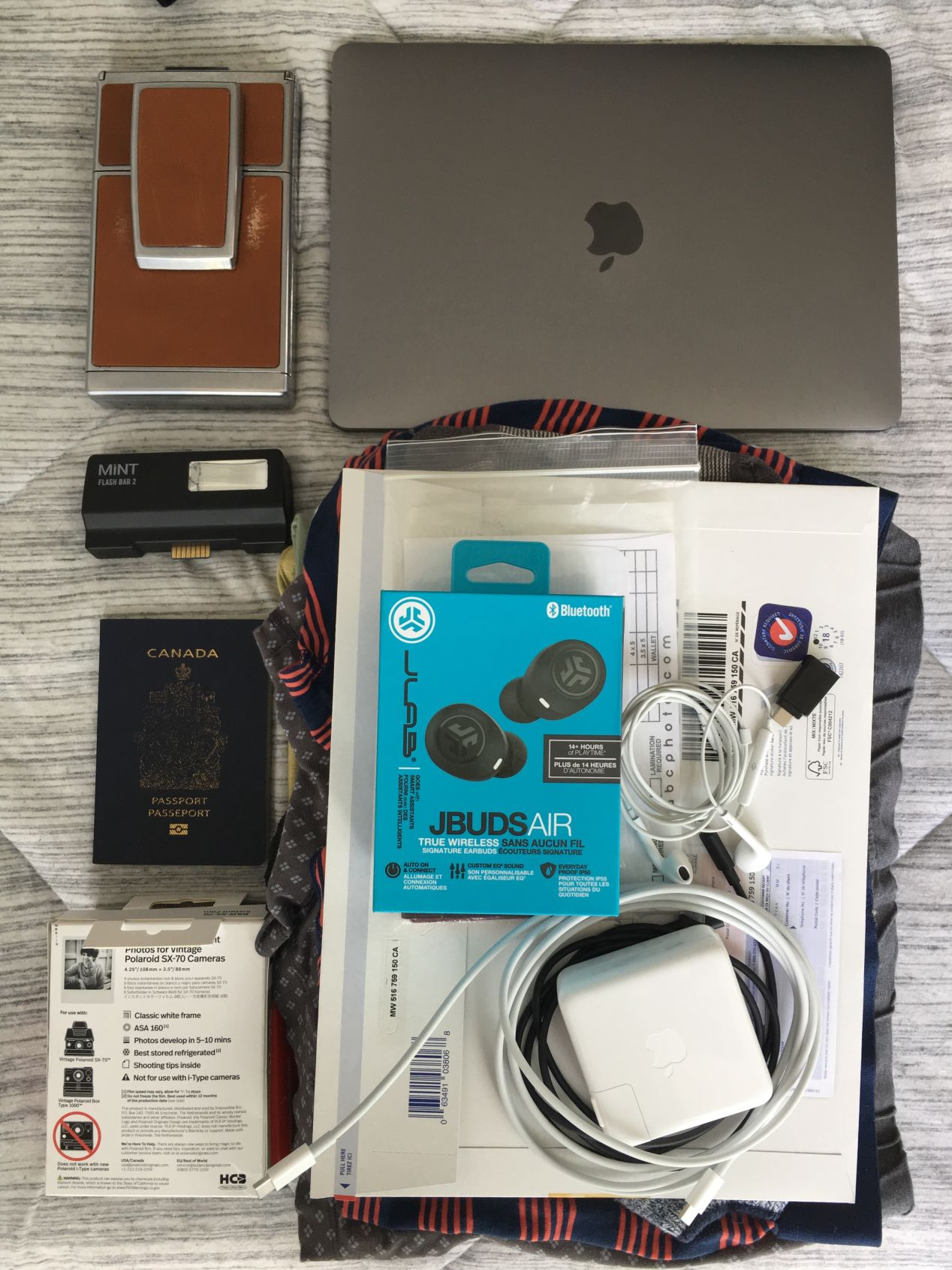 For my week-long trip across Canada to visit my parents, I took my SX-70 with two packs of film, a flash bar, laptop, documents, underwear, shirts, socks, and headphones for my brother, which I brought as a gift. I bought more film once I arrived in Toronto.
