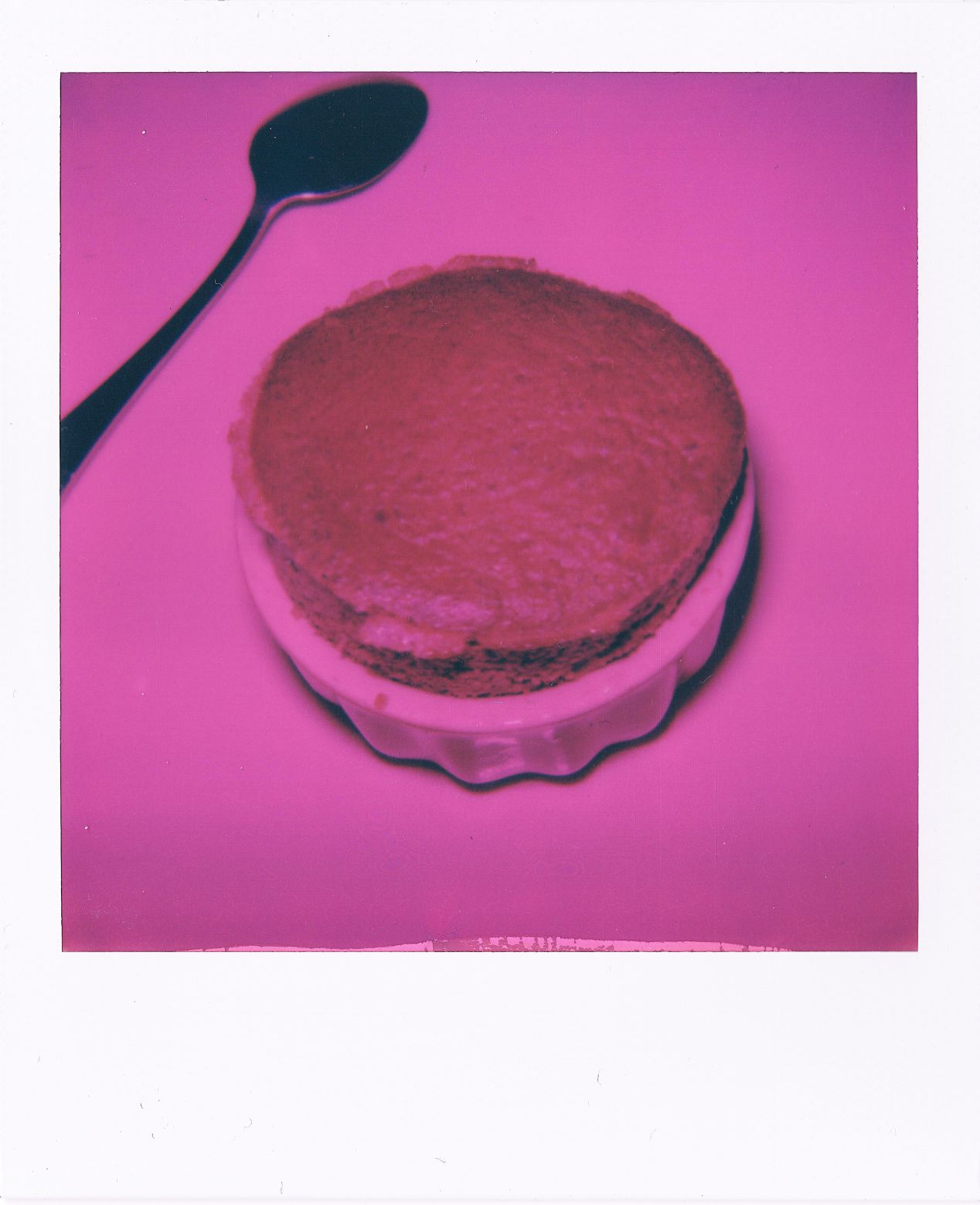 My MiNT Flash pink filter is quite aggressive, though it could be lovely for some ideas. Here I took a picture of a chocolate soufflé in a red ramekin on a white table.