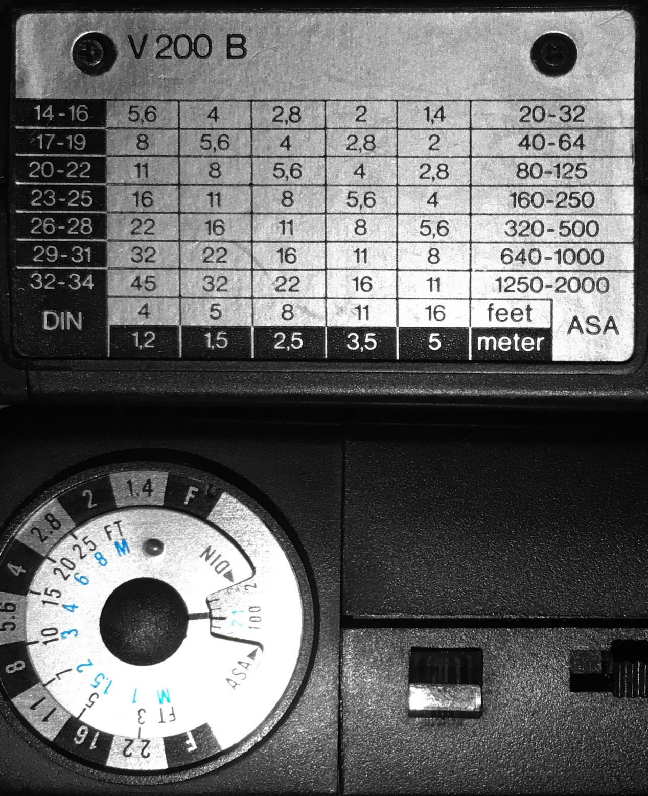 Flashguns may have exposure charts or dials built-in to help you set up your camera for the shot. For example, ISO/ASA 100 film at 1.5 meters will require an aperture of 𝒇8 with the flash above (the one that has a table) or 𝒇16 with the flash below (the one that has a dial).
