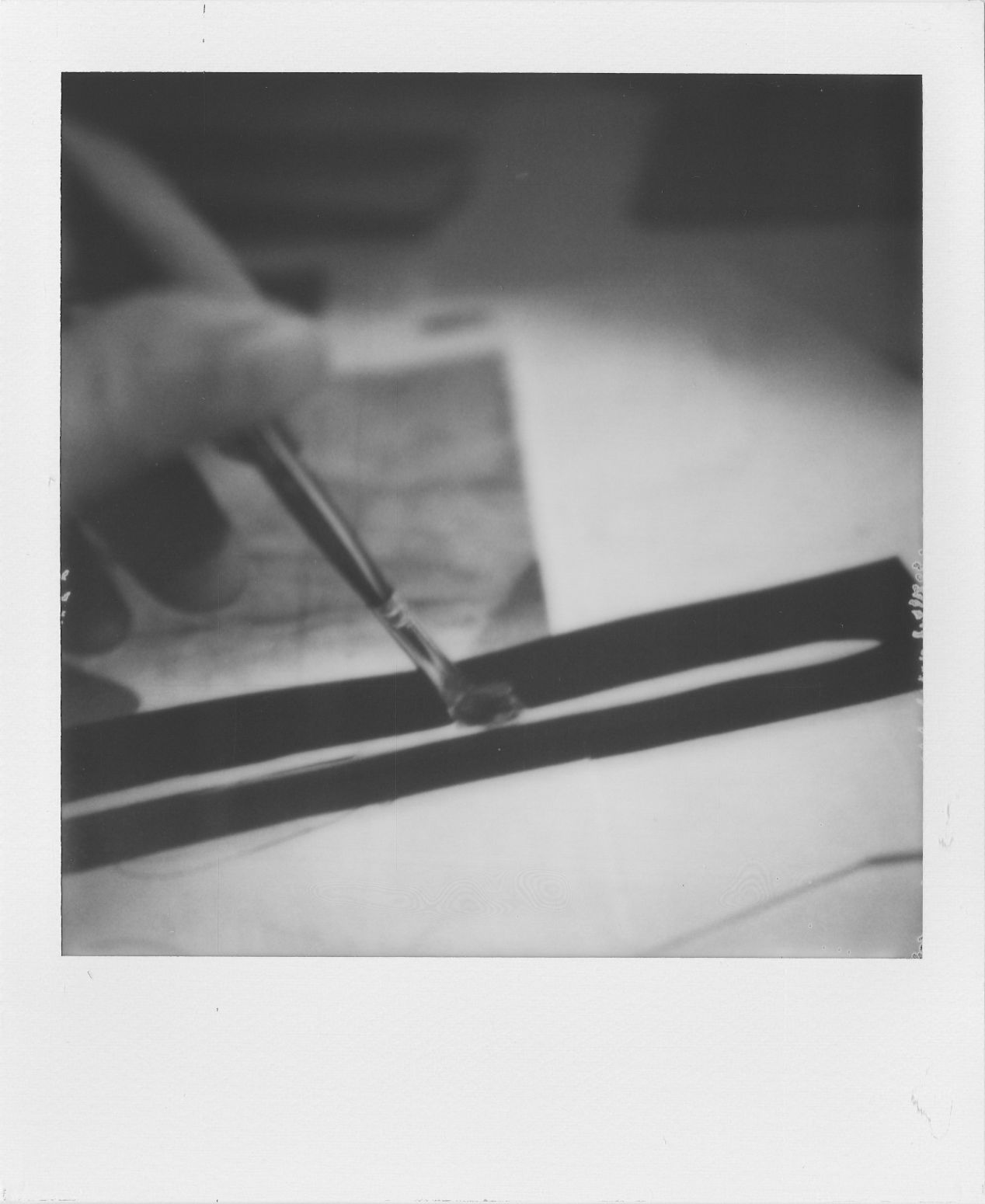 Figure 6. Applying the glue onto the inner side of the cardstock book spine.