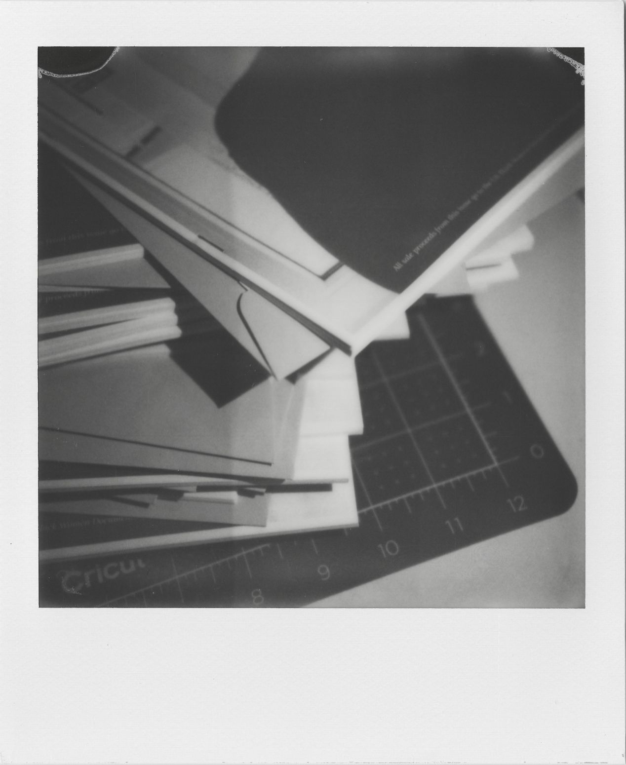 A stack of stapled magazines with perfectly-stacked paper for that nice, flush edge.