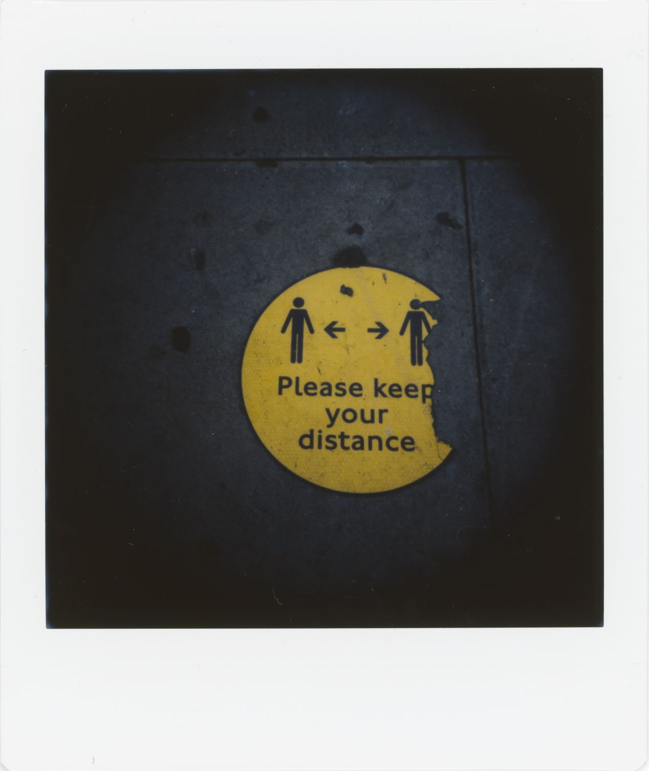 Photograph 4: near a bus stop in North London. As the rule of social distancing has ended, the signage on the pavement no longer needs to be replaced and it is left to fade away and peel off.