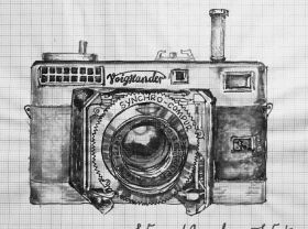 Film camera reviews and guides, illustrated by Betty and Dmitri. Sorted by brand then model. Listings include focusing mechanism and lens information. Primary shooting modes shown: [A]perture/[S]hutter priority, [M]anual, or auto.