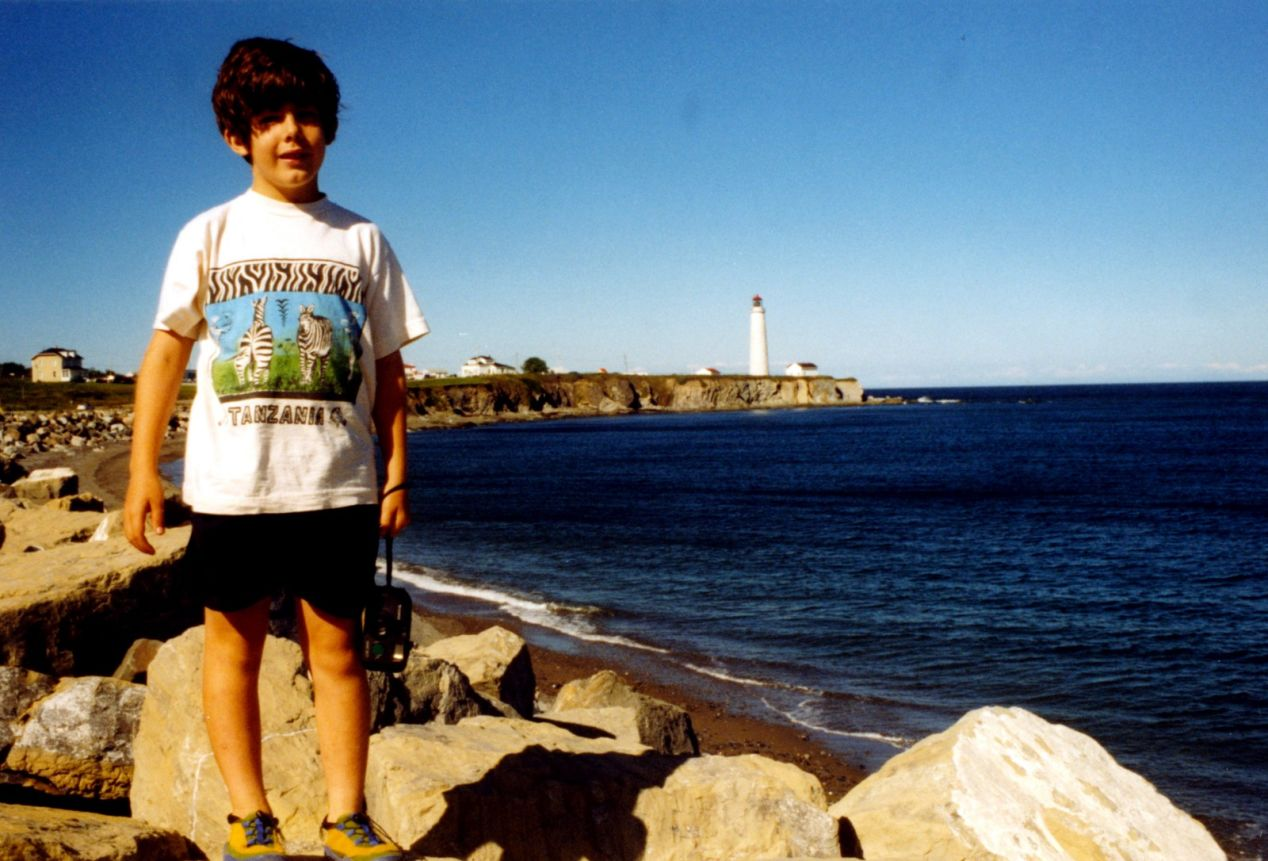 As a kid, somewhere in Gaspésie, QC, with my first camera.