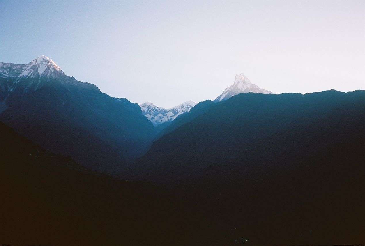 Faint glimpse of Machapuchare mountain ('fishtail' in Nepali), Taken in Ghandruk village, Olympus MujII, Kodak Ektar 100 .