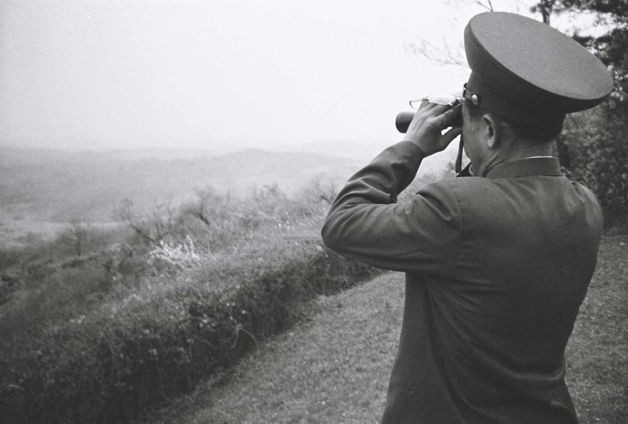 """Watching,"" from the trip to North Korea on May 2016. Shot on Ilford HP5 with Olympus OM-1."