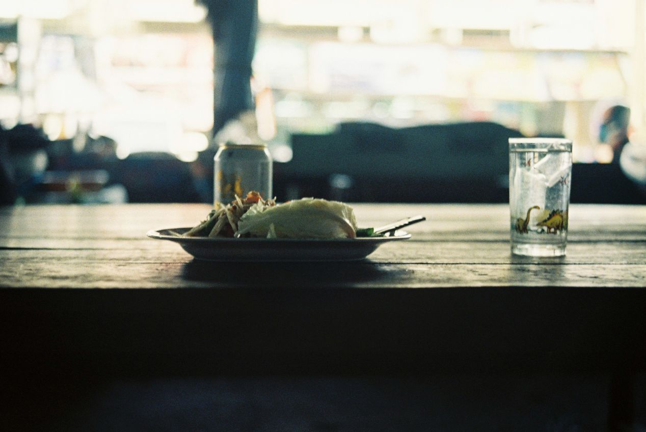 Som Tam salad with Singha beer for lunch. Shot on Kodak UltraMax 400.