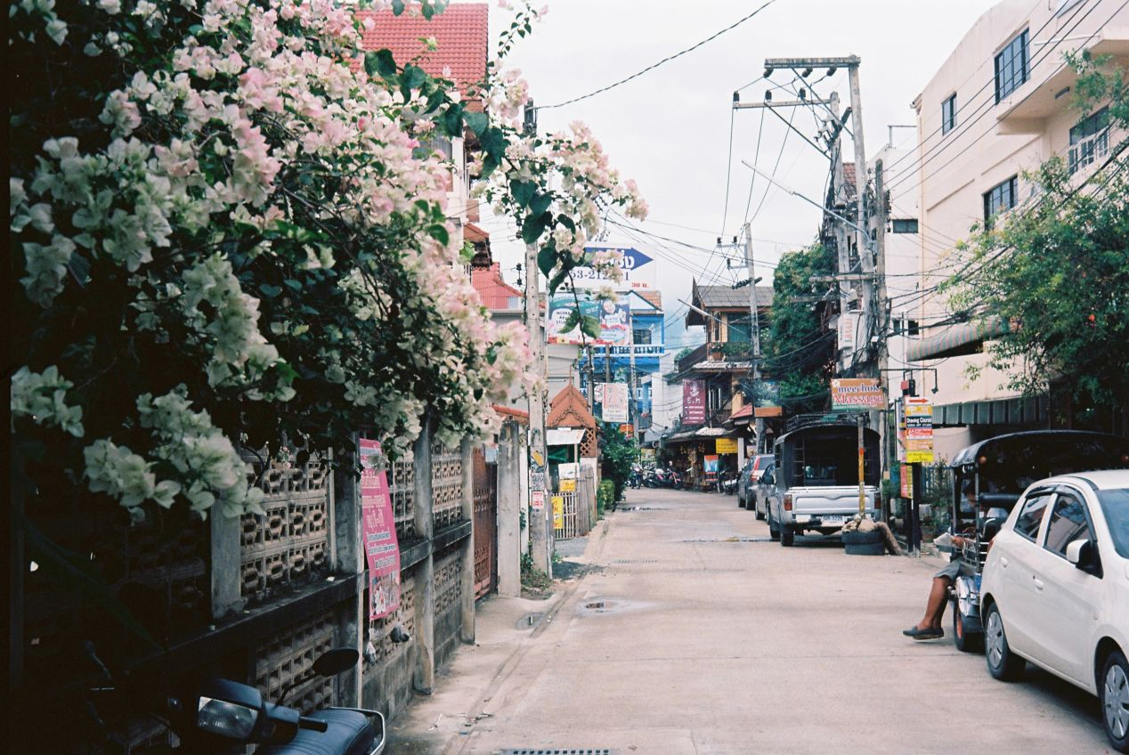 A small street in downtown Chiang Mai that leads to a series of small homes, hostels, cafes and restaurants.