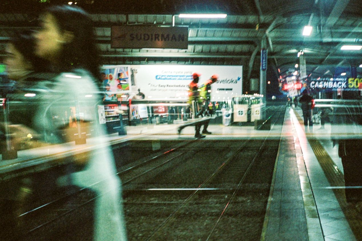 Waiting for the train. Shot on Ricoh 500 GX with Kodak Portra 400.