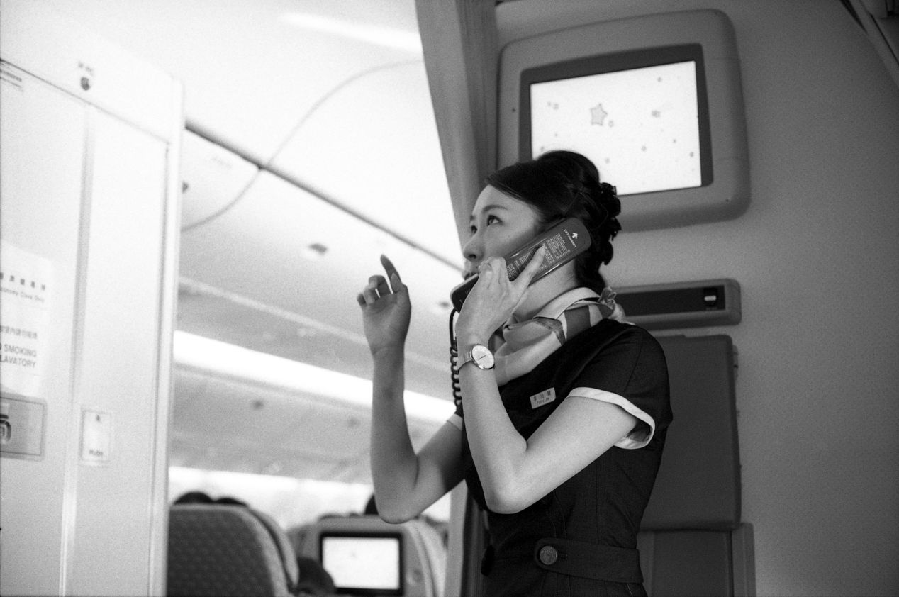 An edgy stewardess sat facing me directly across the emergency exit route. She didn't seem to stay still for one minute during the entire flight. Perhaps it was her first year at the job.