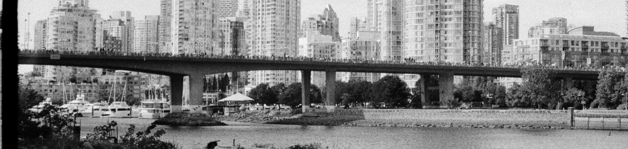 Last photo (monochrome): all traffic lines of Cambie Bridge are filled with a crowd, marching towards downtown Vancouver.