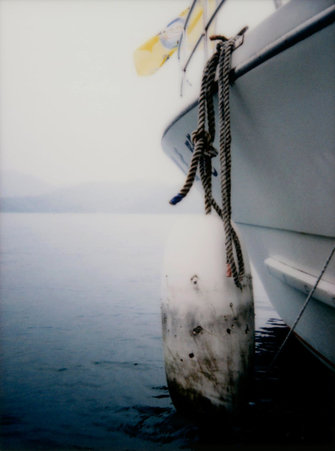 "Perhaps best-composed and best-lit photo from the entire trip. ""The Boat and its Buoy"" - shot on Instax Mini 90."