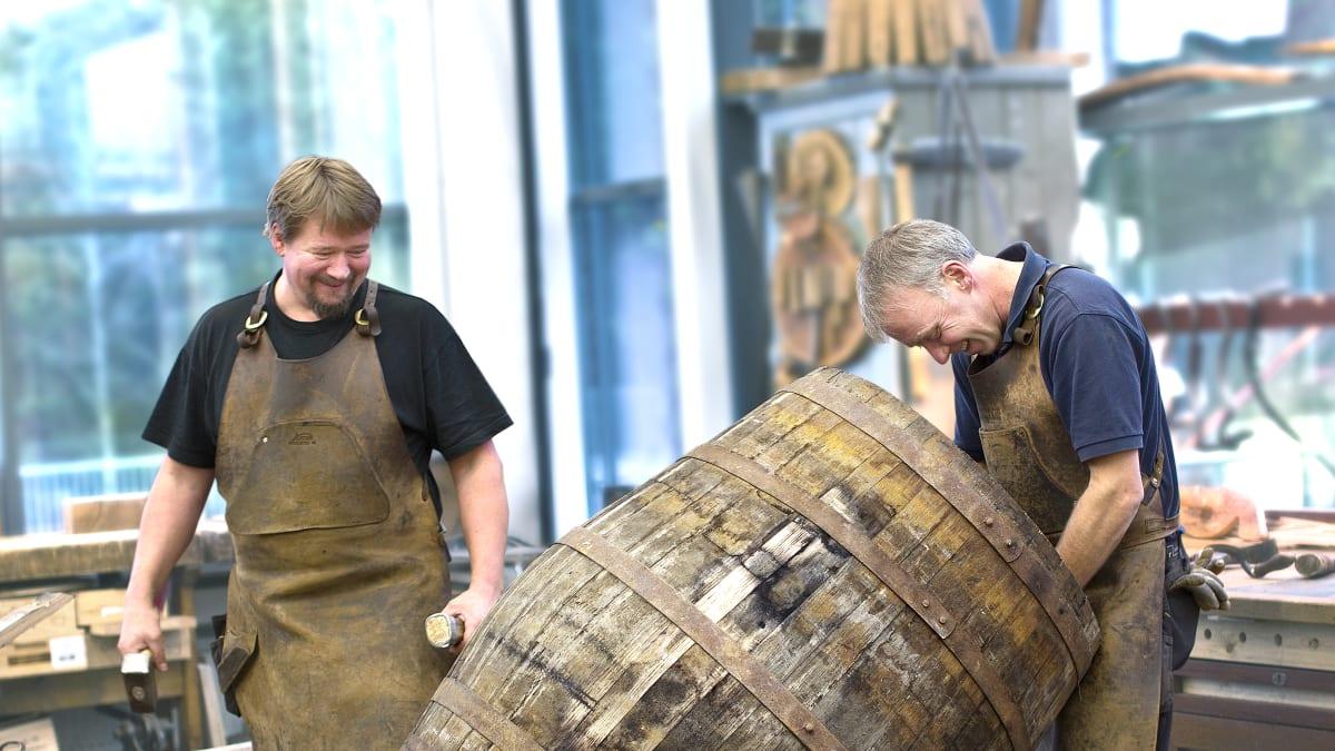 Anora brand image - people making barrels
