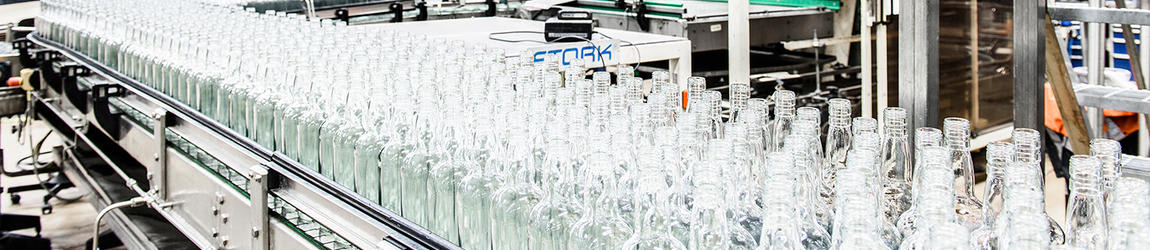 Bottles moving in lines at Rajamäki beverage factory