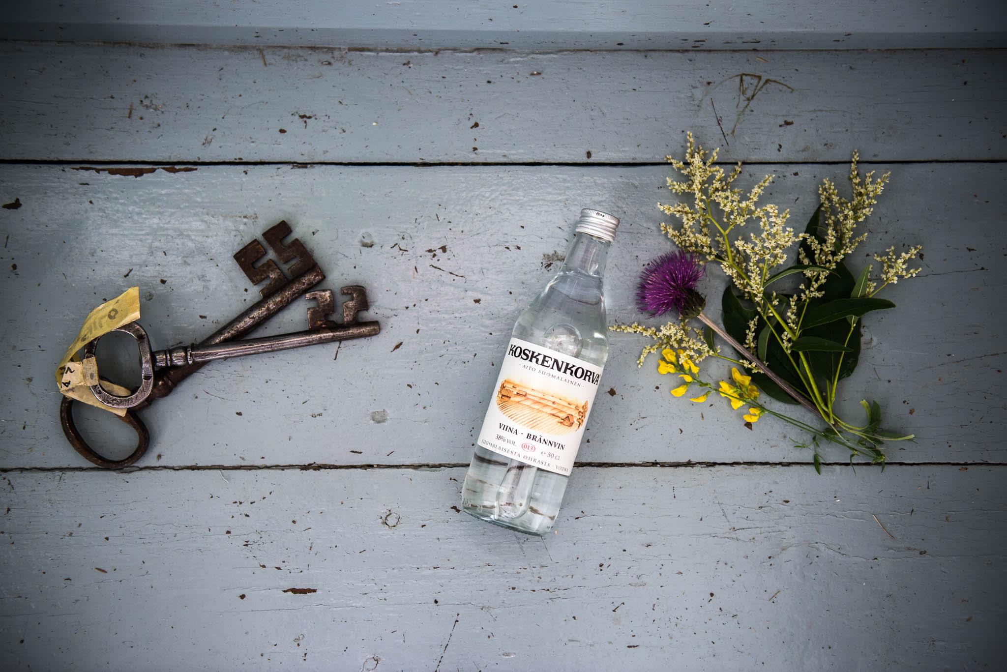 Koskenkorva bottle, old keys and punch of flowers