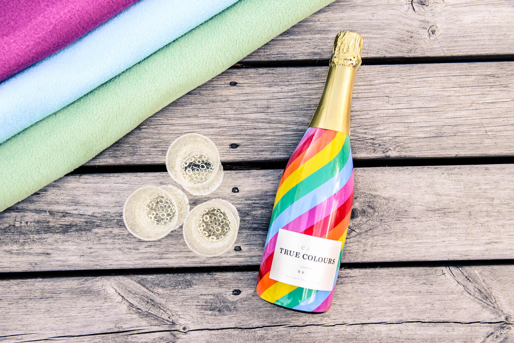 True colours cava with Ultima thule glasses on wood