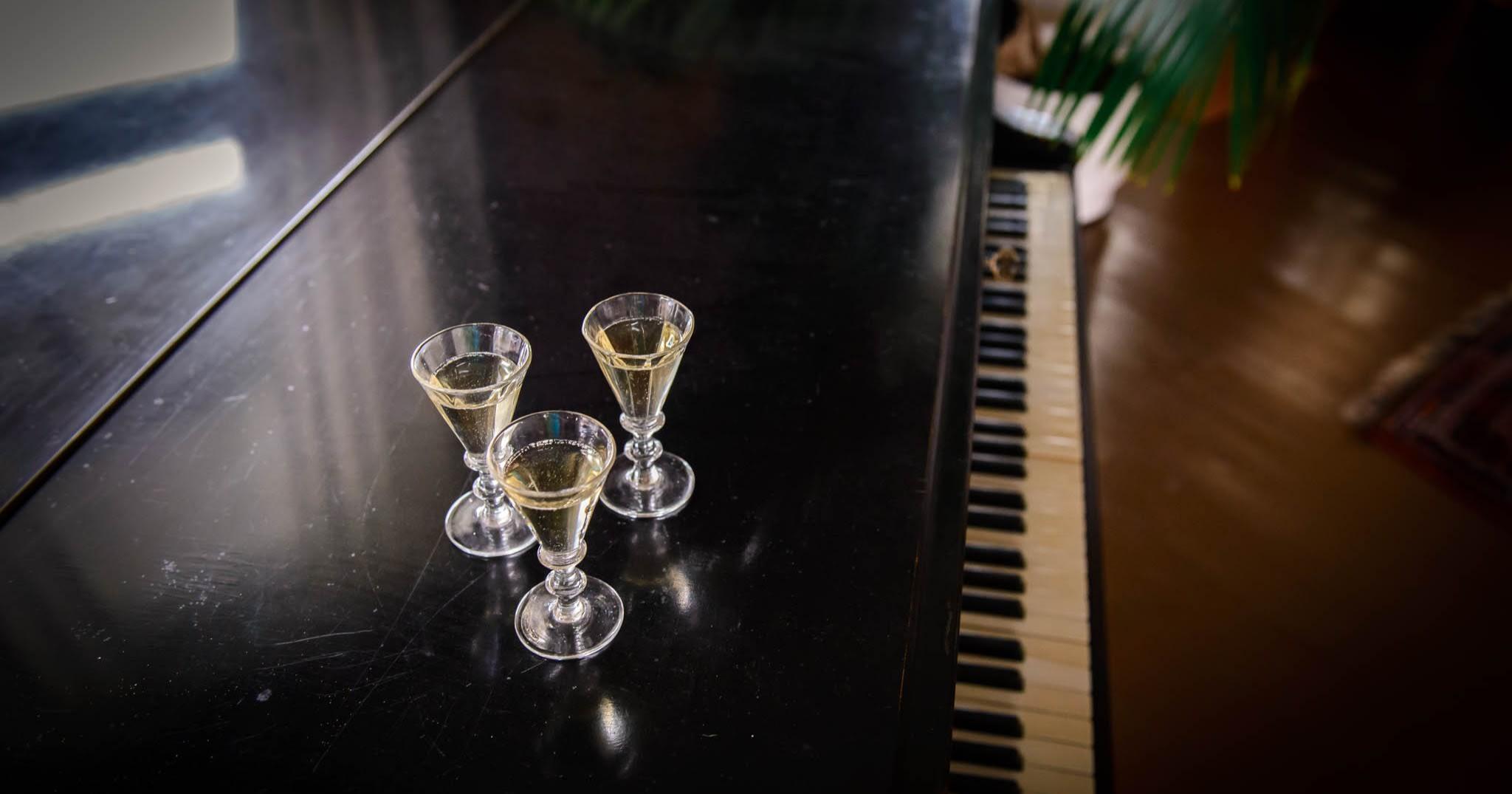 Aquavit glasses on piano