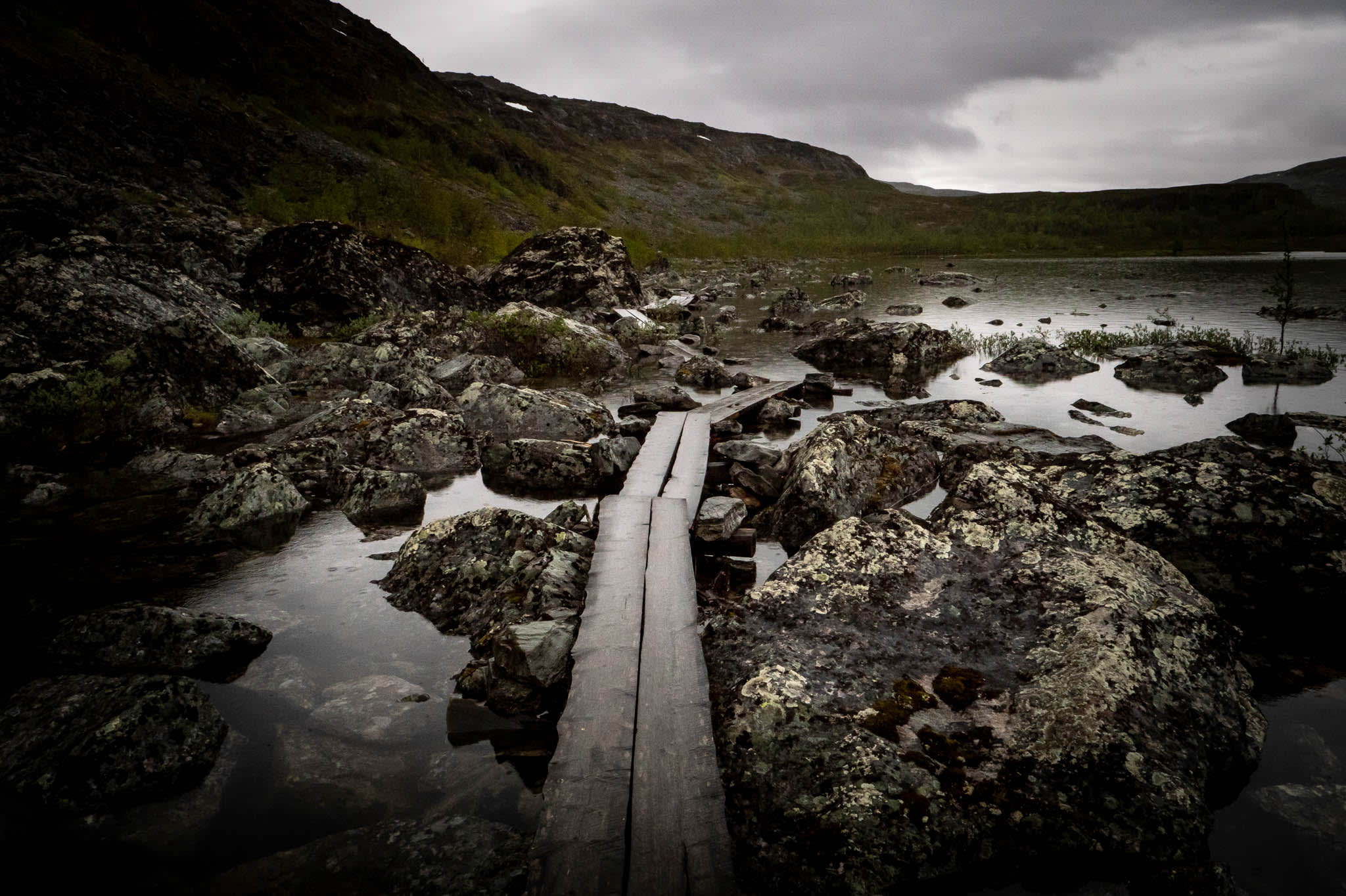 Nordic Nature with path across the rocks and pond
