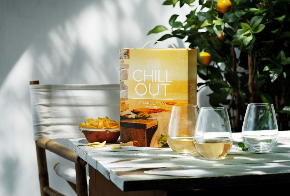 Chill out chardonnay bib on the table with glasses