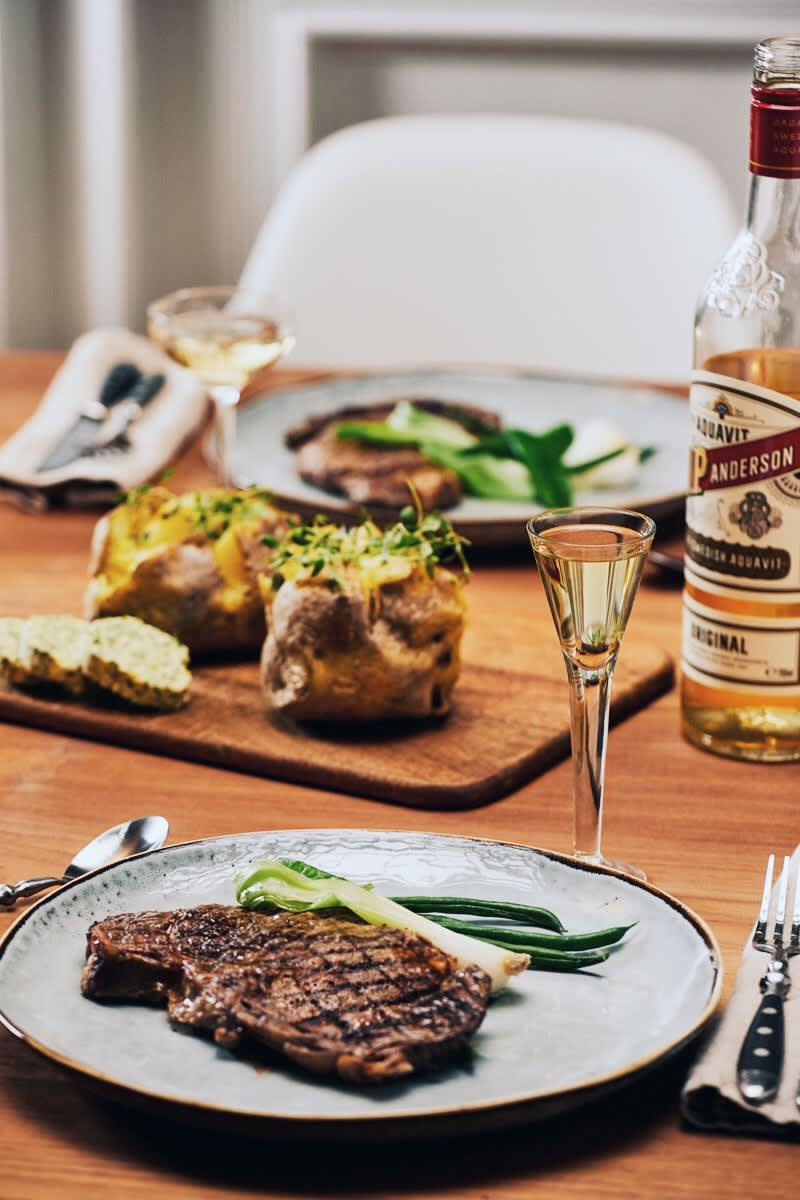 O.P. Anderson with a schnapps and steak