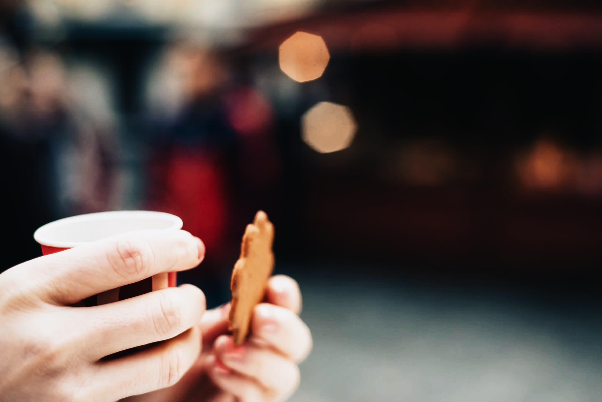 Cookie and cup in hands