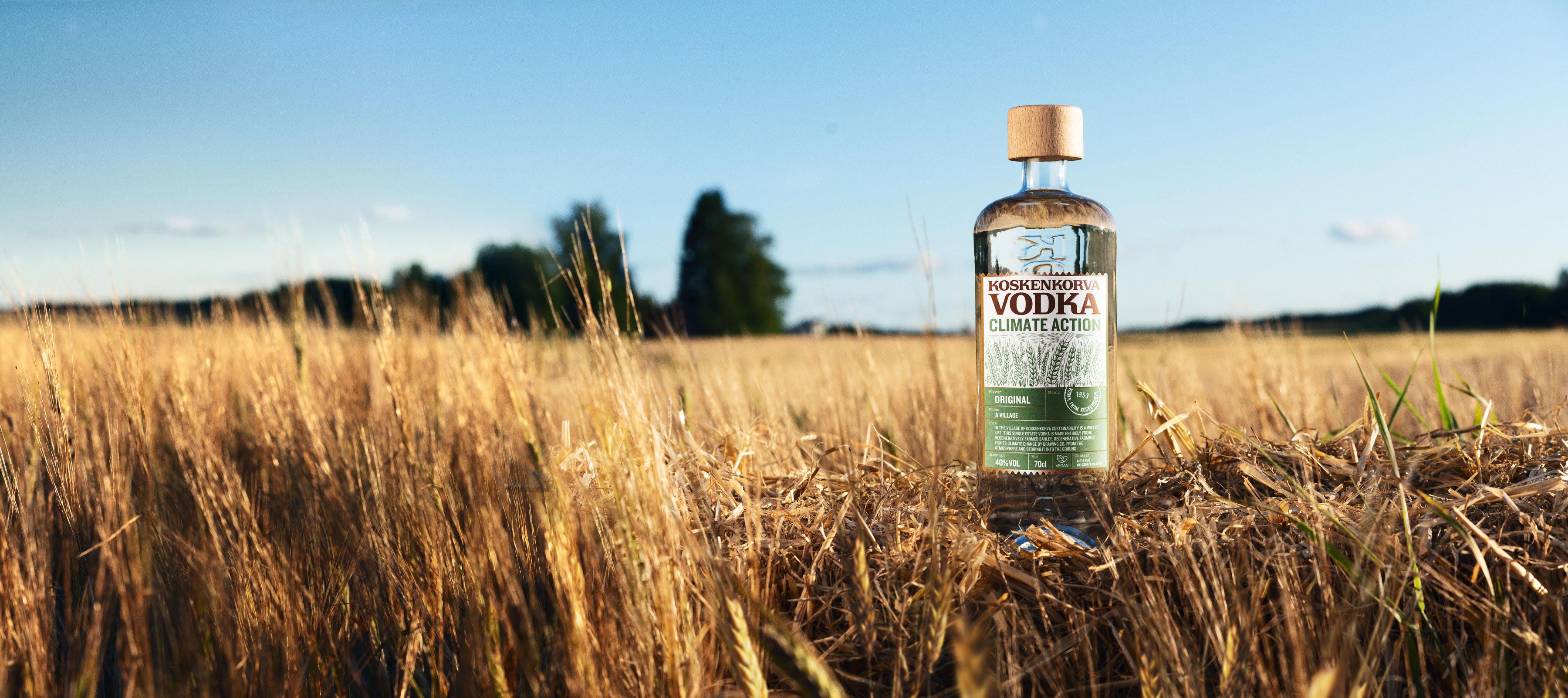 Koskenkorva Vodka Climate Action Bottle on a field
