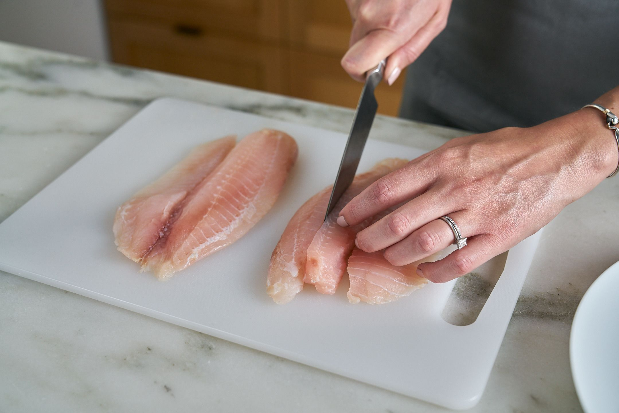 Cut fish into pieces.