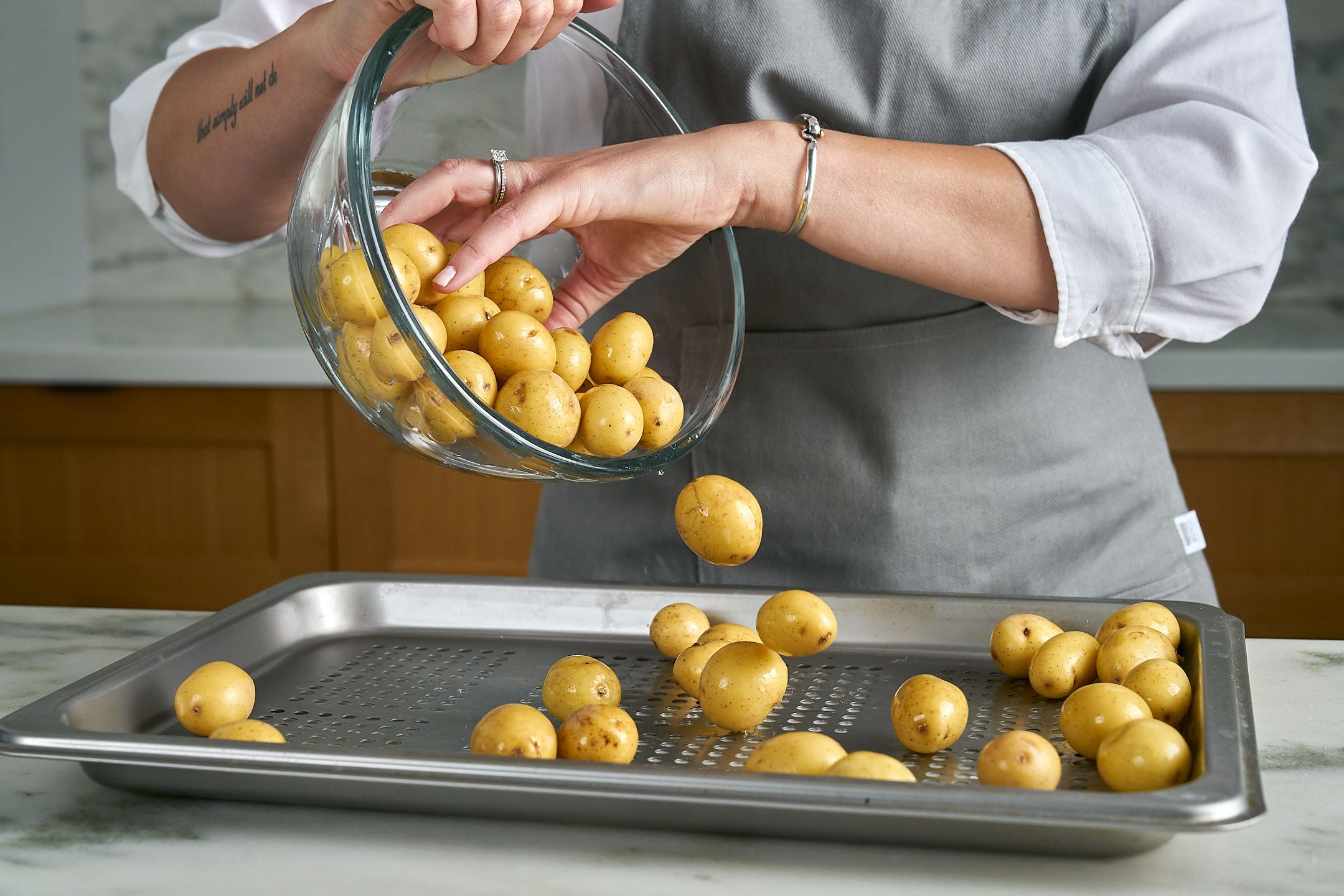 Place potatoes on Perforated Pan.