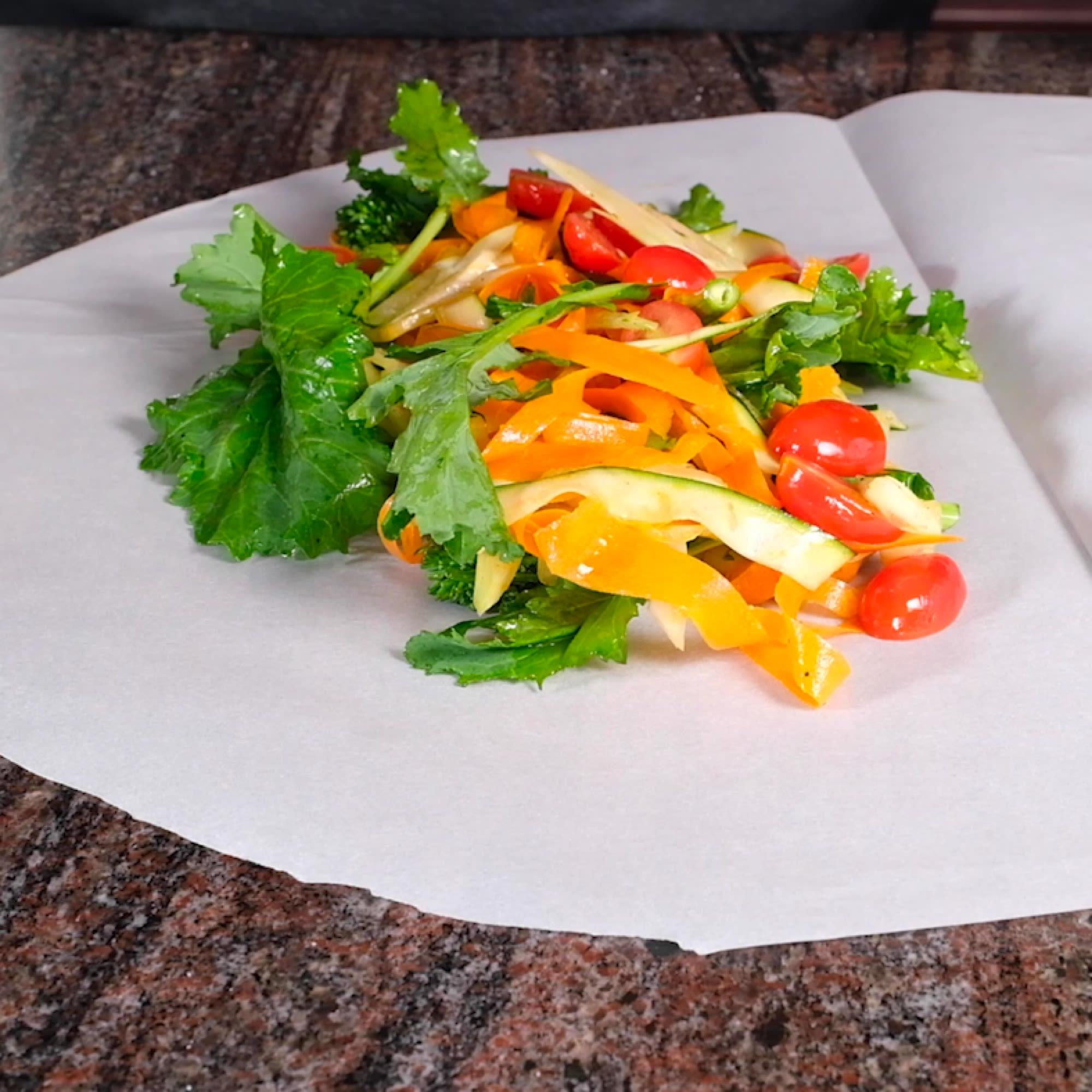 Open parchment and arrange vegetables.