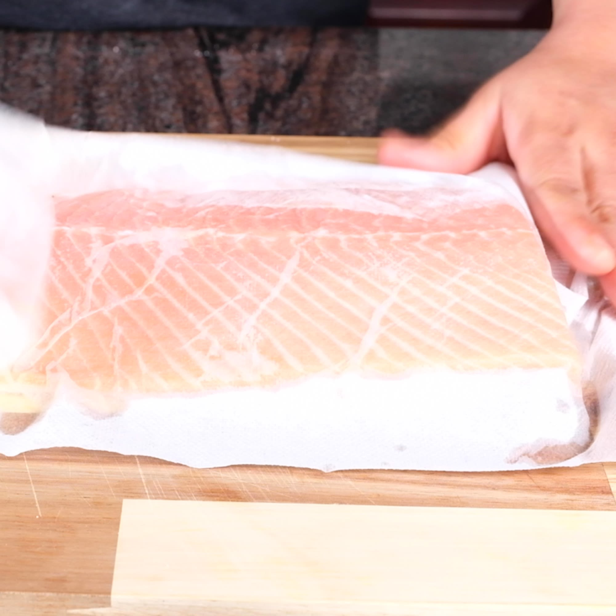 Take Salmon out of ice bath and pat dry.