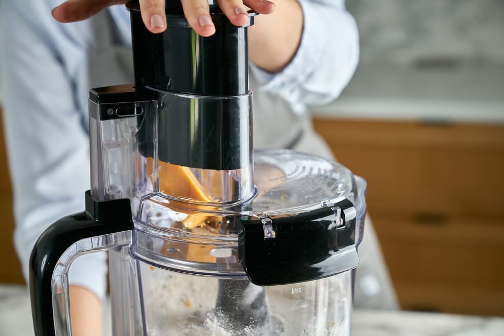 Grate cheese into food processor