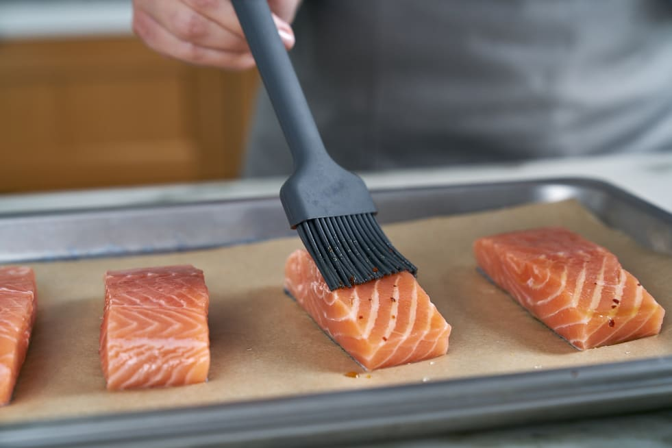 Place salmon on parchment lined Solid Pan and glaze.
