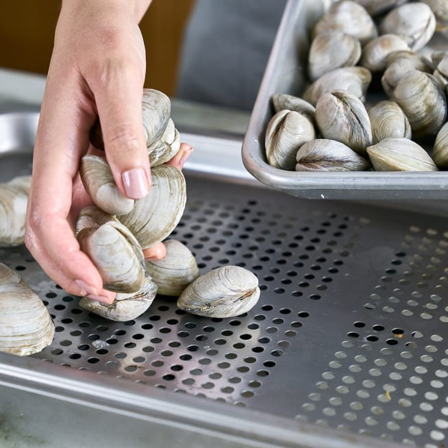 Add clams to perforated pan