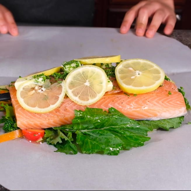 Place Salmon directly on bed of vegetables.