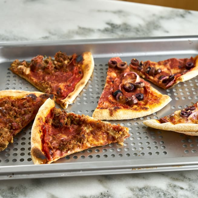 Place pizza on perforated pan