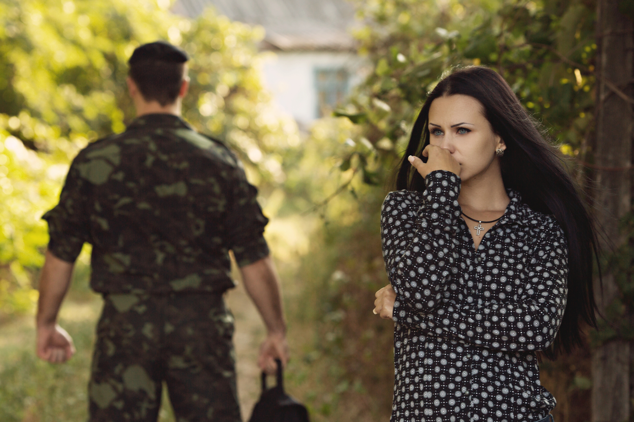 Military man turning his back on his distressed wife