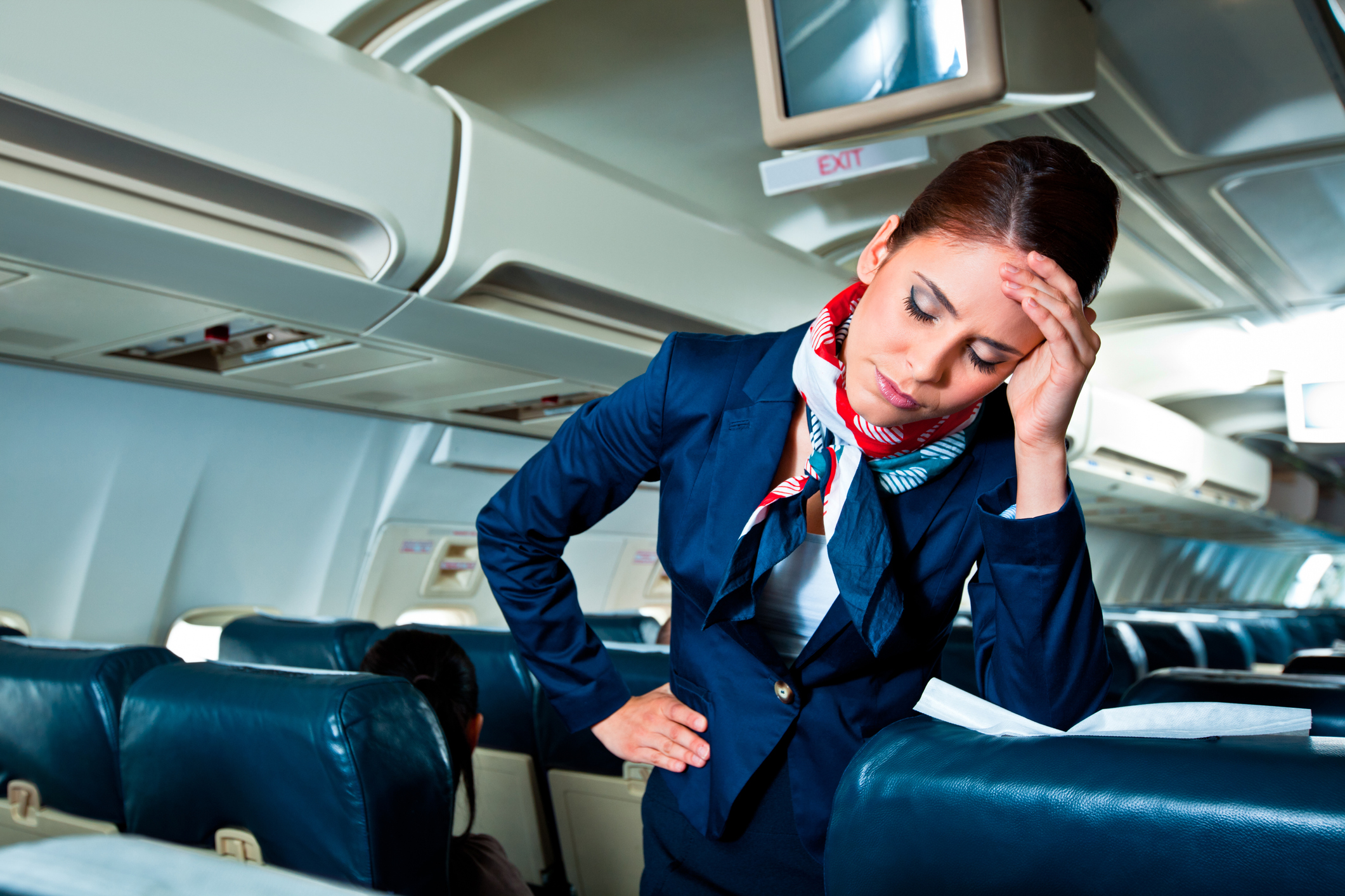Frustrated female flight attendant on an empty airplane