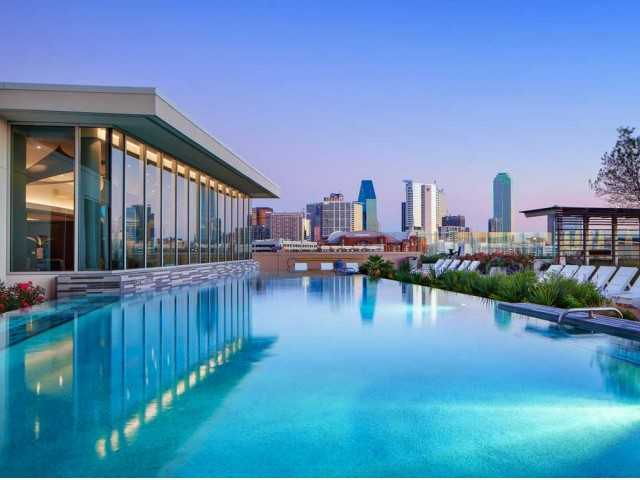 AMLI Design District - Enjoy incomparable amenities including a one-acre rooftop with panoramic views of downtown Dallas; infinity-edge pool; cabanas; fire pit; relaxation area with 100-inch outdoor movie screen; 3,000-square-foot, state-of-the-art fitness center; java bar; covered pet promenade; 24-hour lobby attendant; concierge services and more