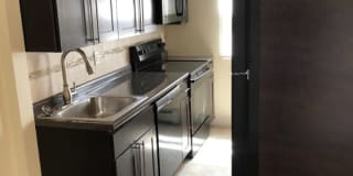 Village Arms Apartments Photo Gallery 1