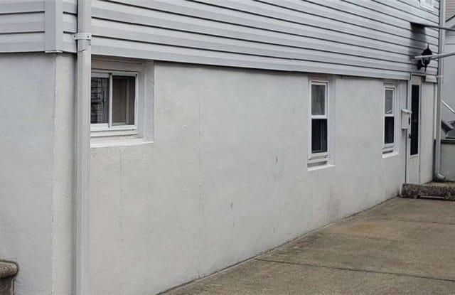 64 Graywood Road - 64 Graywood Road, Manorhaven, NY 11050